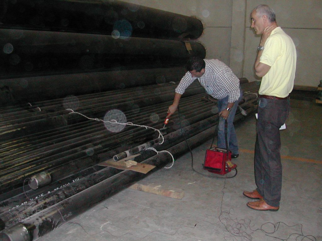 HOLIDAY TEST OF PIPES COATED WITH PROTEGOL 32-55 1,5 mm thk.